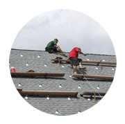 Men doing roof repair