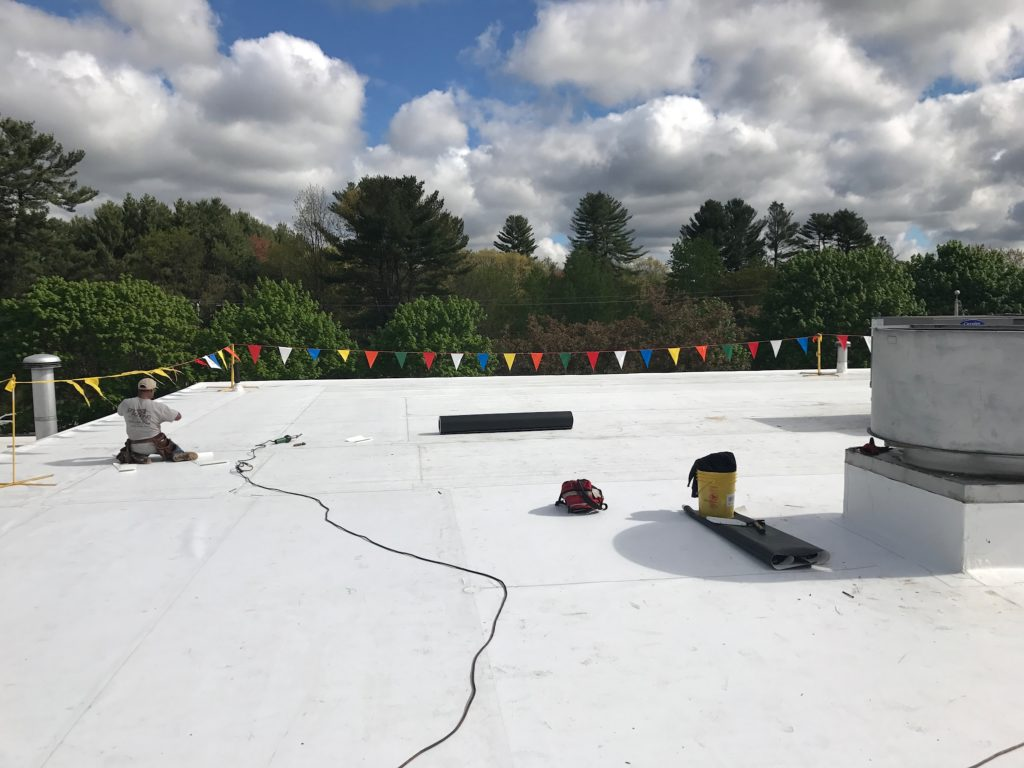 commercial rubber roof installed by roofing contractors